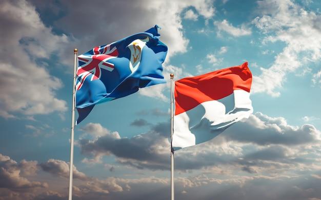 Belle bandiere dello stato nazionale dell'indonesia e anguilla insieme sul cielo blu
