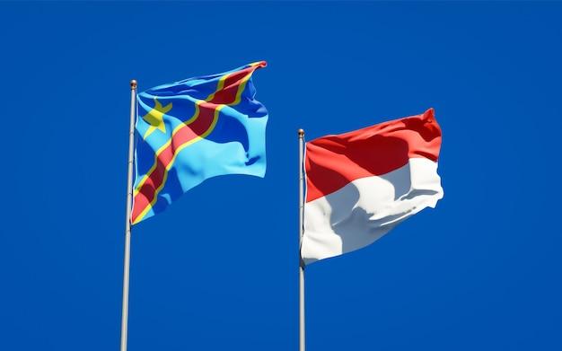 Belle bandiere nazionali di stato dell'indonesia e del congo insieme sul cielo blu