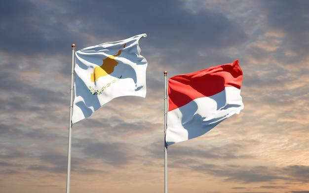 Belle bandiere di stato nazionali di indonesia e cipro insieme sul cielo blu