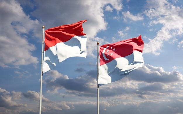 Belle bandiere di stato nazionali di indonesia e singapore insieme