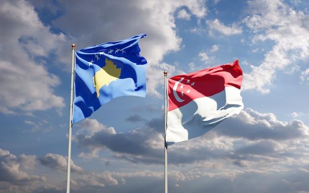 Belle bandiere nazionali dello stato del kosovo e singapore insieme