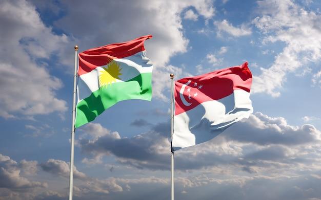 Belle bandiere di stato nazionali del kurdistan e singapore insieme