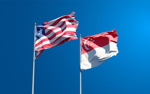 Belle bandiere di stato nazionali della liberia e singapore insieme