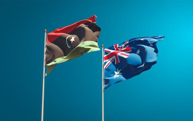 Belle bandiere di stato nazionali della libia e dell'australia insieme
