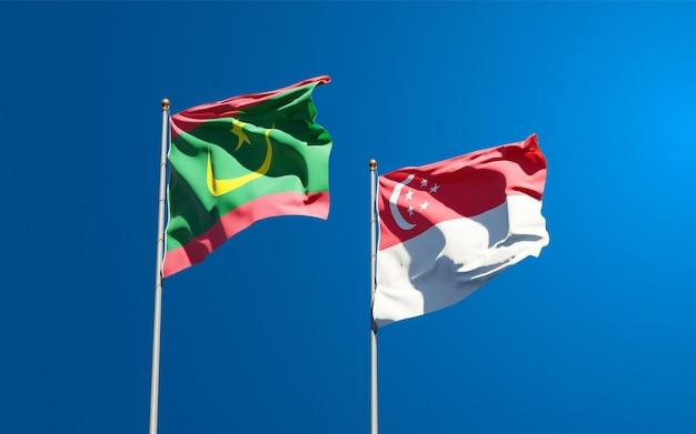 Belle bandiere nazionali di stato della mauritania e singapore insieme
