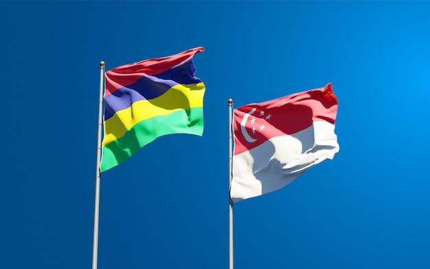 Belle bandiere di stato nazionali di mauritius e singapore insieme