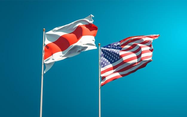 Belle bandiere di stato nazionali della nuova bielorussia e stati uniti insieme