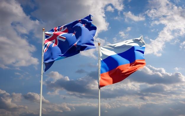 Belle bandiere di stato nazionali della nuova zelanda e della russia insieme sul cielo blu. grafica 3d