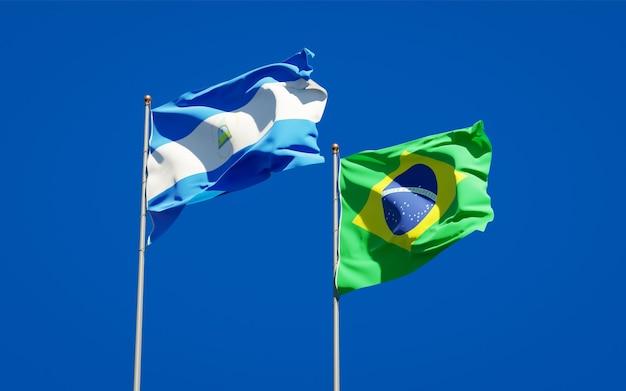 Belle bandiere nazionali dello stato del nicaragua e del brasile insieme sul cielo blu