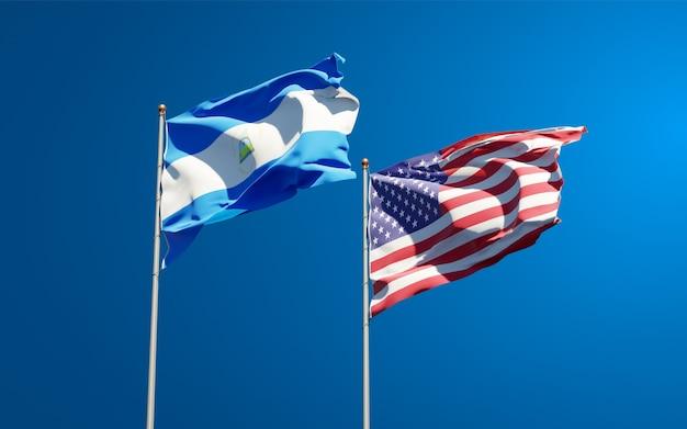 Belle bandiere di stato nazionali del nicaragua e degli stati uniti insieme