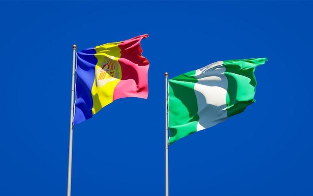 Belle bandiere dello stato nazionale della nigeria e andorra insieme sul cielo blu
