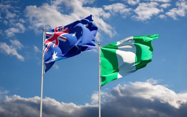 Belle bandiere di stato nazionali della nigeria e dell'australia insieme sul cielo blu