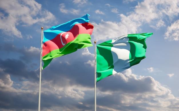 Belle bandiere di stato nazionali della nigeria e dell'azerbaigian insieme sul cielo blu