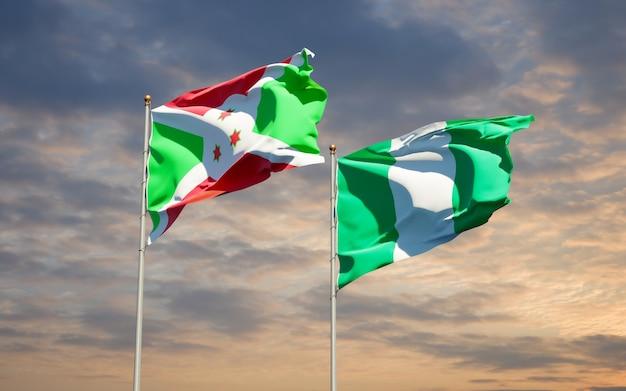 Belle bandiere dello stato nazionale della nigeria e del burundi insieme sul cielo blu Foto Premium