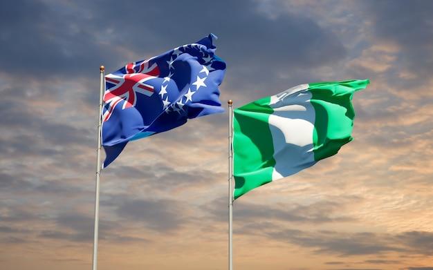 Belle bandiere dello stato nazionale della nigeria e dell'isola di cook insieme sul cielo blu