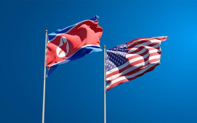 Belle bandiere di stato nazionali della corea del nord e stati uniti insieme