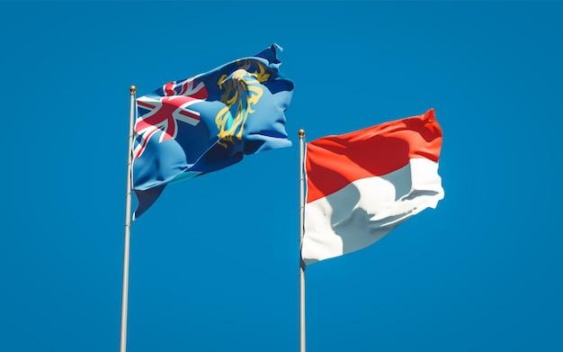 Belle bandiere nazionali dello stato delle isole pitcairn e indonesia insieme sul cielo blu