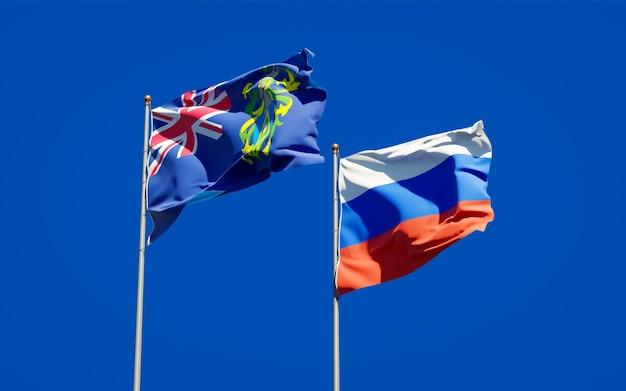 Belle bandiere nazionali dello stato delle isole pitcairn e della russia insieme sul cielo blu. grafica 3d