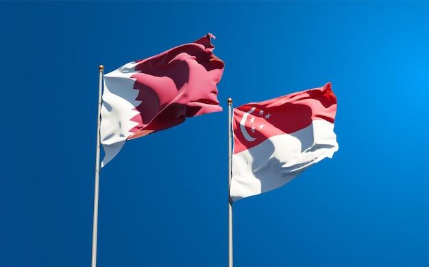 Belle bandiere di stato nazionali del qatar e singapore insieme