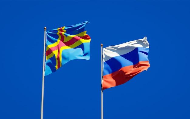 Belle bandiere nazionali dello stato della russia e delle isole aland insieme sul cielo blu. grafica 3d