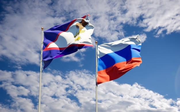 Bandiere di stato nazionale belle della russia e samoa americane insieme sul cielo blu. grafica 3d