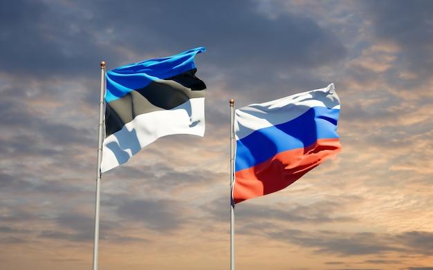 Belle bandiere di stato nazionali della russia e dell'estonia insieme sul cielo blu. grafica 3d