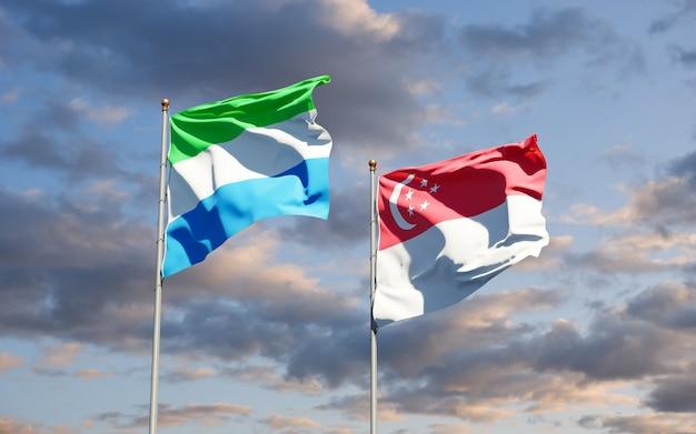 Belle bandiere nazionali dello stato della sierra leone e singapore insieme