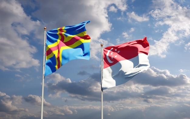 Belle bandiere nazionali dello stato di singapore e isole aland