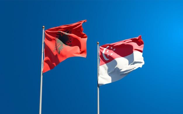 Belle bandiere di stato nazionali di singapore e albania