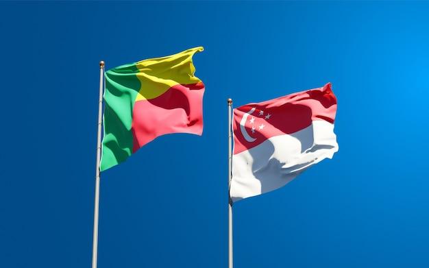 Belle bandiere di stato nazionali di singapore e benin