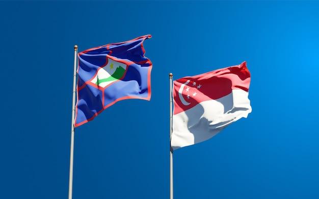 Belle bandiere nazionali dello stato di sint eustatius e singapore insieme