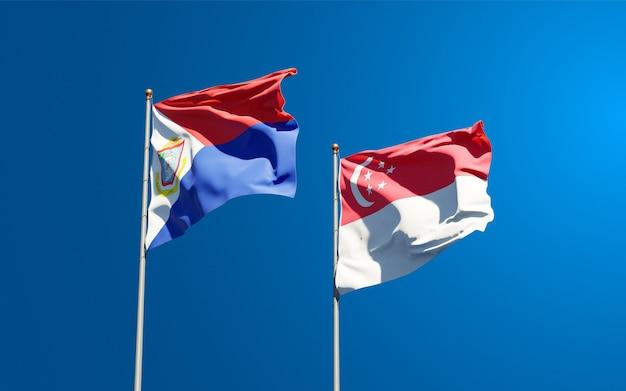 Belle bandiere di stato nazionali di sint maarten e singapore insieme
