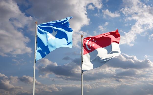 Belle bandiere di stato nazionali della somalia e singapore insieme