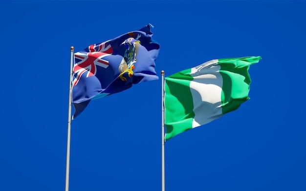 Belle bandiere di stato nazionali della georgia del sud e delle isole sandwich meridionali e nigeria insieme sul cielo blu