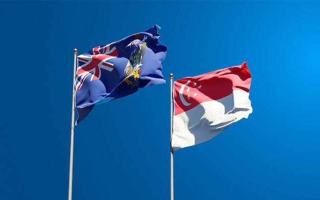 Belle bandiere di stato nazionali della georgia del sud e delle isole sandwich meridionali e singapore