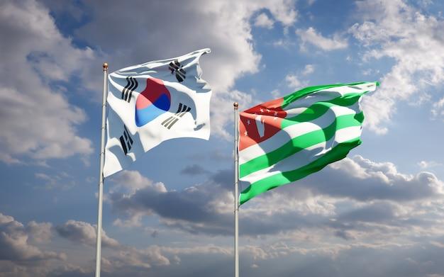 Belle bandiere di stato nazionali della corea del sud e dell'abkhazia insieme