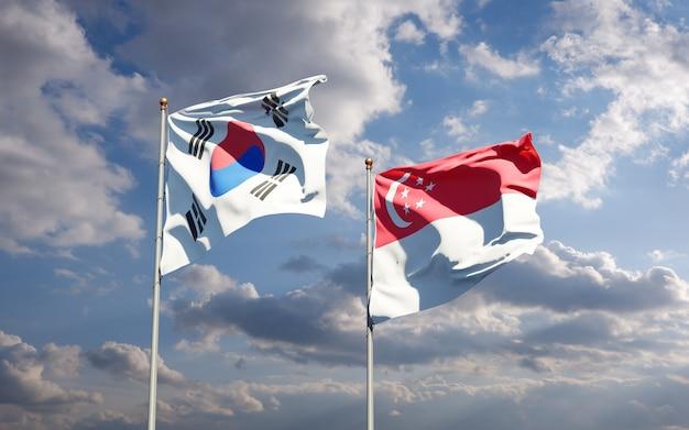 Belle bandiere di stato nazionali della corea del sud e singapore insieme
