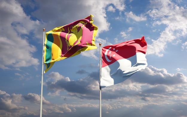 Belle bandiere di stato nazionali dello sri lanka e singapore insieme
