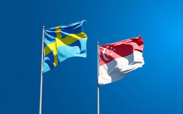 Belle bandiere di stato nazionali di svezia e singapore insieme