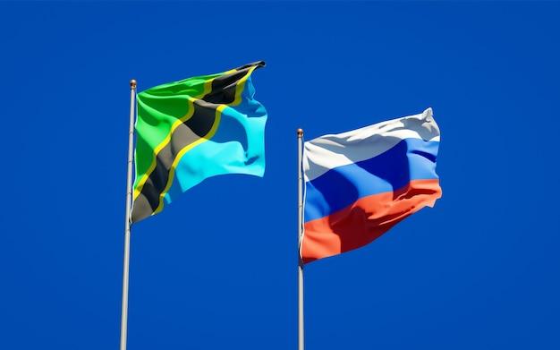 Belle bandiere di stato nazionali della tanzania e della russia insieme sul cielo blu. grafica 3d