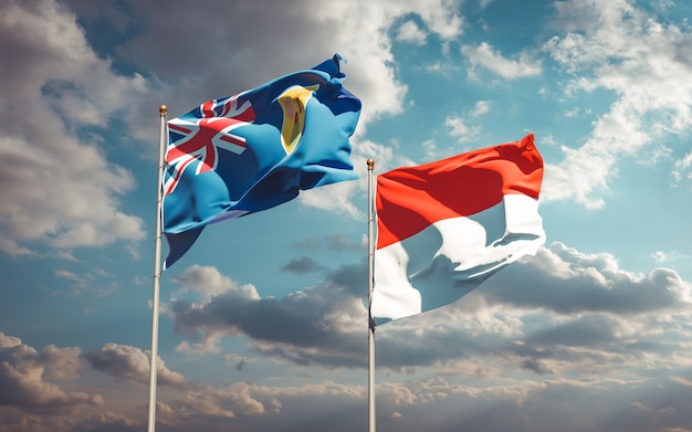 Belle bandiere nazionali dello stato delle isole turks e caicos e indonesia insieme sul cielo blu
