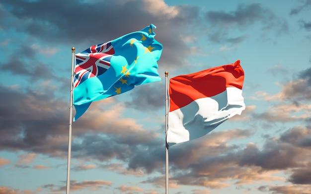 Belle bandiere nazionali dello stato di tuvalu e indonesia insieme sul cielo blu