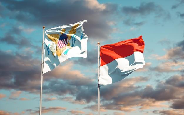 Belle bandiere di stato nazionali delle isole vergini degli stati uniti e indonesia insieme sul cielo blu