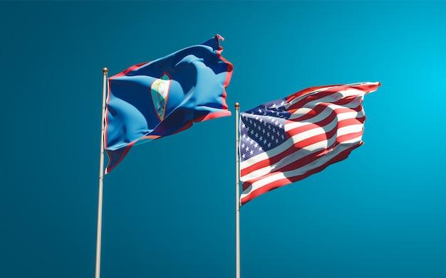 Belle bandiere di stato nazionali di usa e guam insieme
