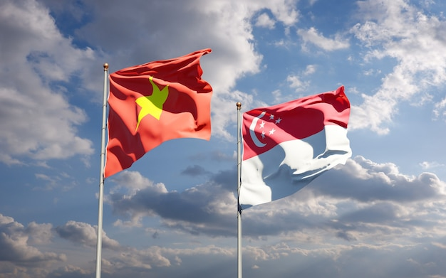 Belle bandiere di stato nazionali del vietnam e singapore insieme