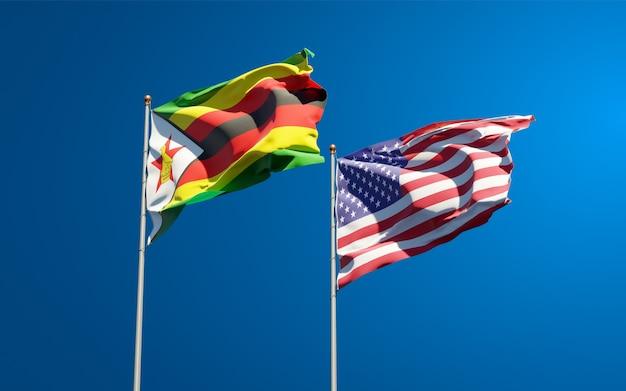 Belle bandiere di stato nazionali dello zimbabwe e degli stati uniti insieme
