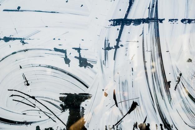 Bella trama di sovrapposizione del vecchio vetro della finestra sporca