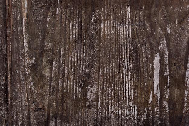 Bella trama di sovrapposizione del vecchio muro di legno.