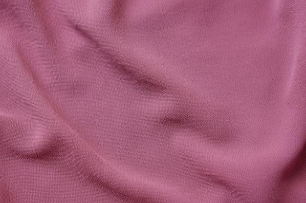 Bella trama di sfondo di stoffa polverosa rosa, bellissimo primo piano di stoffa Foto Premium