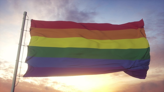 Una bellissima bandiera arcobaleno dell'organizzazione lgbt vola nel cielo. le bandiere dell'orgoglio lgbt sono utilizzate da lesbiche, gay, bisessuali, transgender e altre persone. rendering 3d